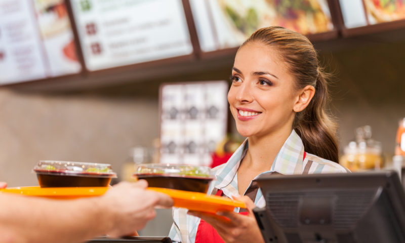 Restaurant worker serving two fast food meals